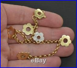 14k YELLOW GOLD VINTAGE CHARM BRACELET WITH flower 5 CHARMS. (BW61)