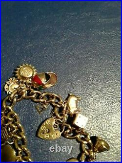 9ct Gold Vintage Charm Bracelet with 19 charms and safety chain 40grams