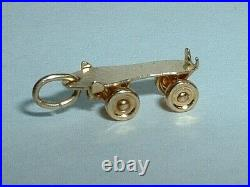VINTAGE 14k YELLOW GOLD 3D MOVEABLE ROLLER SKATE CHARM