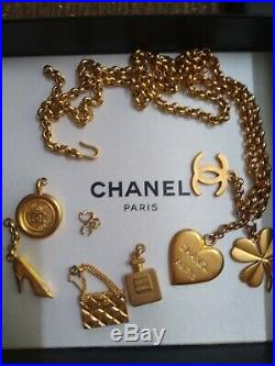 Vintage Chanel necklace with 7 charms, gold tone, the real deal